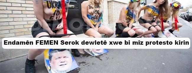 Endamên FEMEN Serok dewletê xwe bi mîz protesto kirin