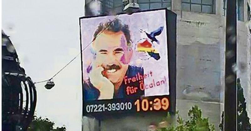 Li Stuttgartê di şaşeya reklamê de wêneyê Evdille Ocalan dadgerên Elman gêj kirin